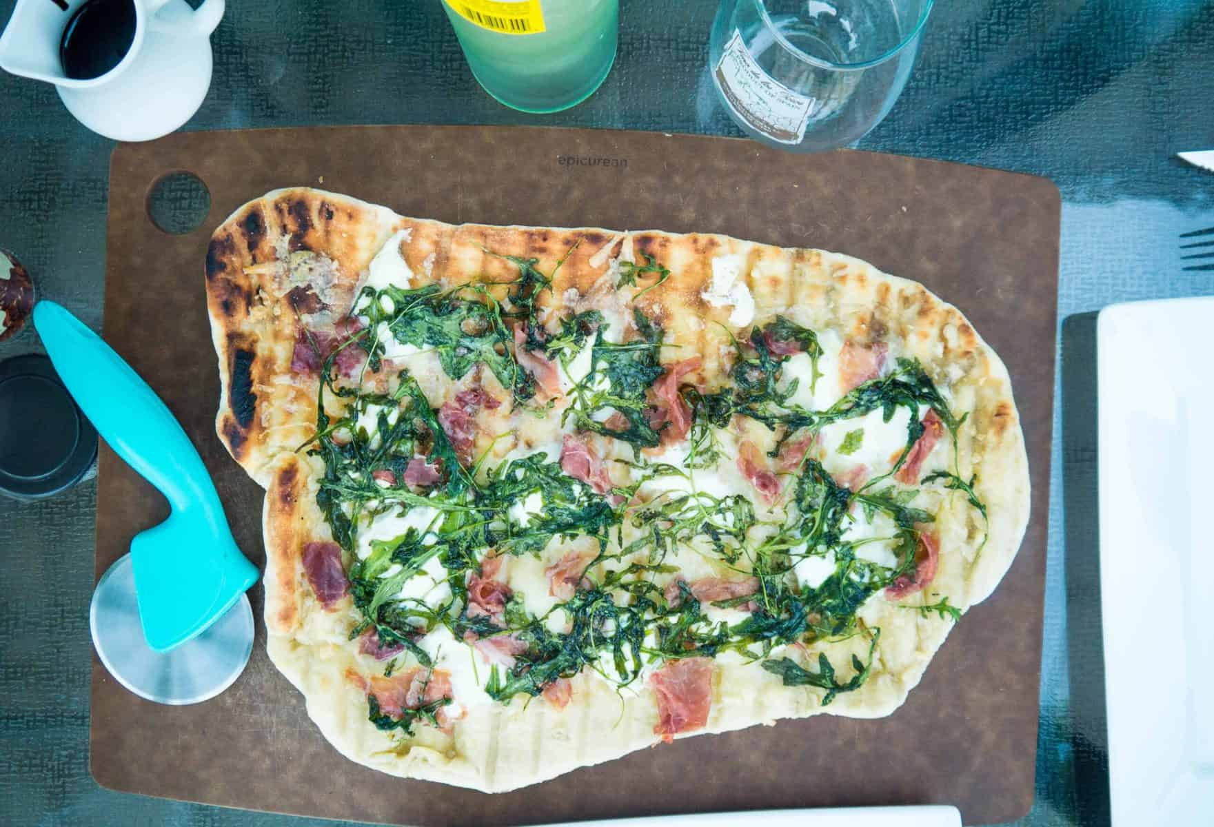Grilled Prosciutto And Garlic Ricotta Pizza With Arugula And Balsamic Glaze Sip And Spice